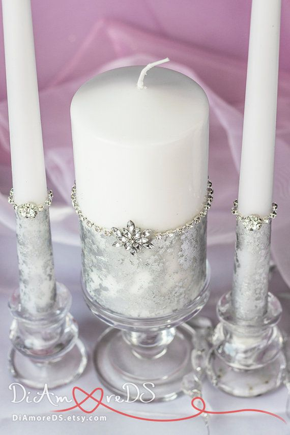 Silver candle set carefully designed and decorated with silver and white snoflakes, clear rhinestones. Take care of your wedding pictures with DiAmoreDS wedding accessories and you are going to remember this day for life!  Exclusive products from DiAmoreDS are perfect for your special day, or as a unique gift for an anniversary or newlyweds. You can use the designer decor for parties on the occasion of birthday, baby shower, and other celebrations  ❤ Buy this item and get it worldwide with…