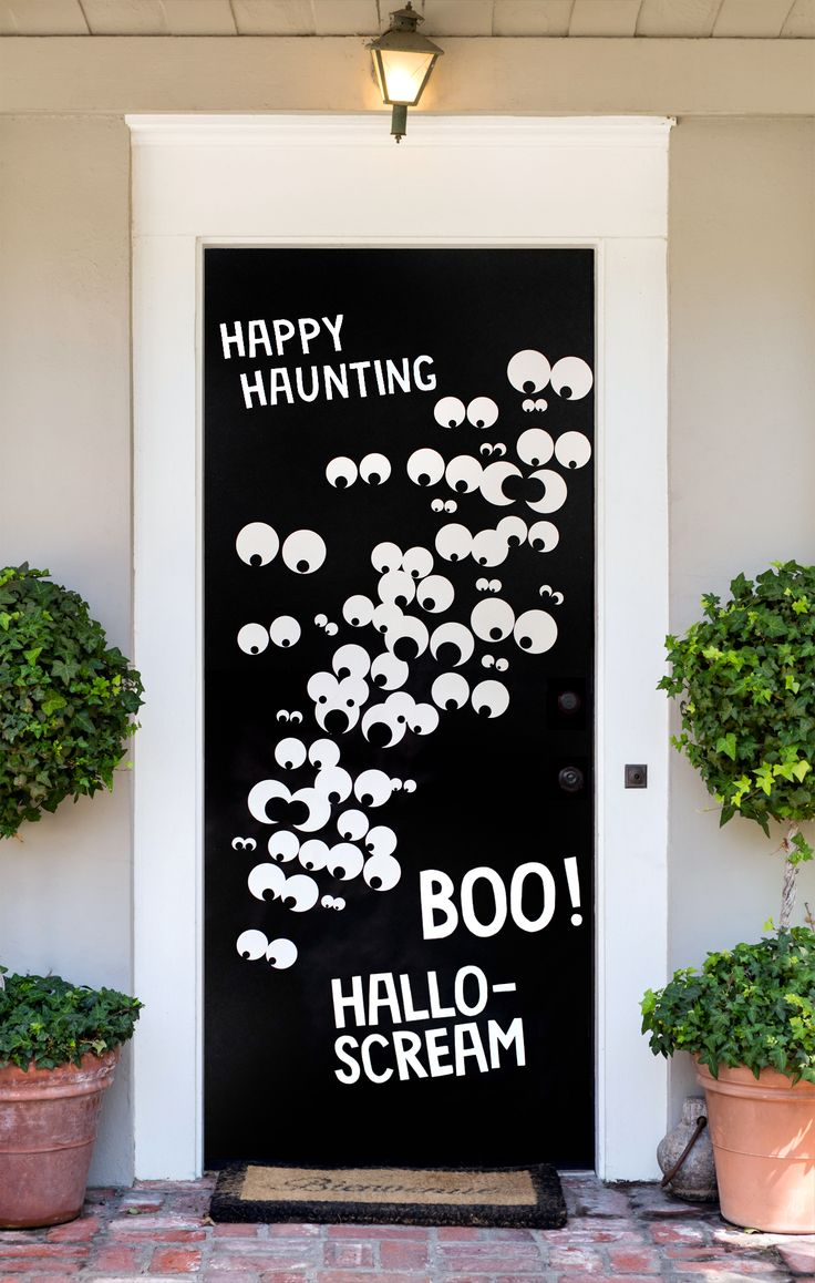 Make your house a must-see hotspot this year with our Door Cover DIY. This Halloween decoration idea is just the right amount of both fun and spooky for visiting trick-or-treaters. Click in for full instructions.