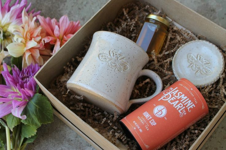 Our Bee & Tea Box features a handmade mug and tea dish, Honey Cup herbal tea, raw honey, and a sweet tea infuser with honeybee charm! Available for a limited time with limited quantities.