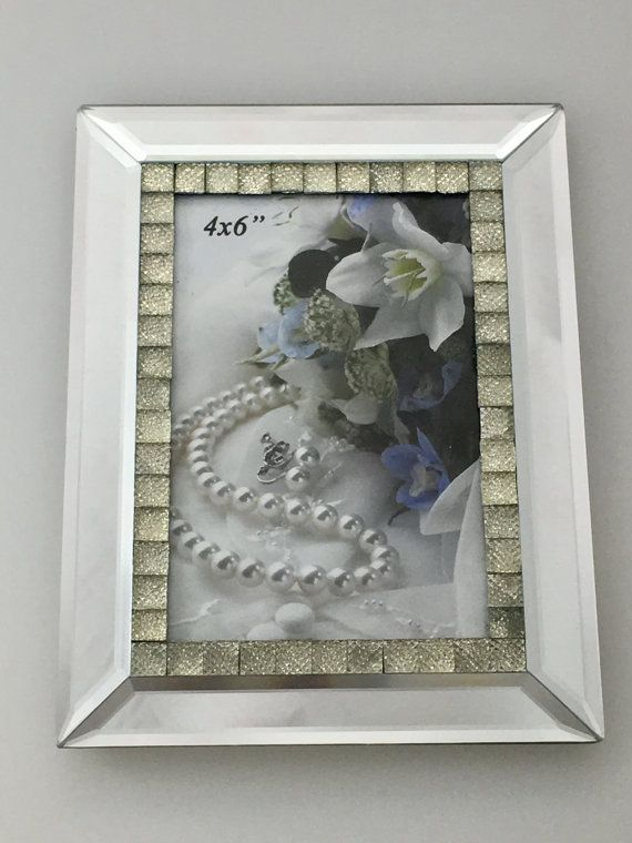 """Mirrored  Photo Frame With Large Crystal Inlay 4 X 6      Features        Photo frame - modern and simple      Great for displaying those special moments and precious memories      Portrait      Fits picture size 4"""" x 6""""  Frame Size: 15.5cm x 20cm    Package Contents        1 x Photo frame      1 x White Box    Only $30.00 plus Shipping World Wide 