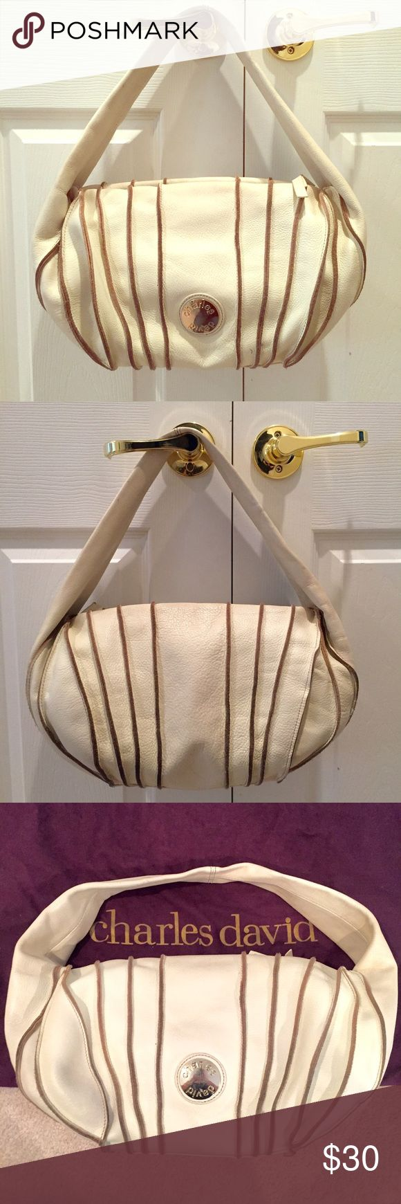 ⚡️SALE⚡️Charles David Genuine Leather Hobo This beautiful genuine leather off white Charles David handbag has a soft beige lining inside and comes with a dust bag. Charles David Bags Hobos