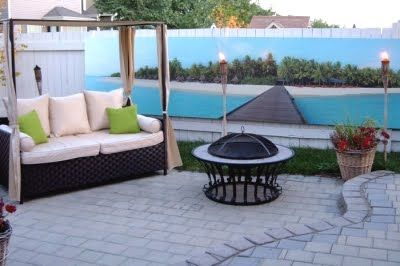 Put a mural on your fence to create a beach feel in your back yard