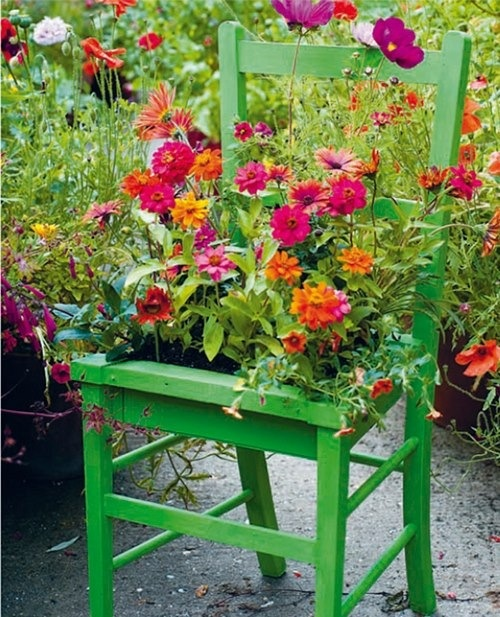 .a cute little green chair turned planter