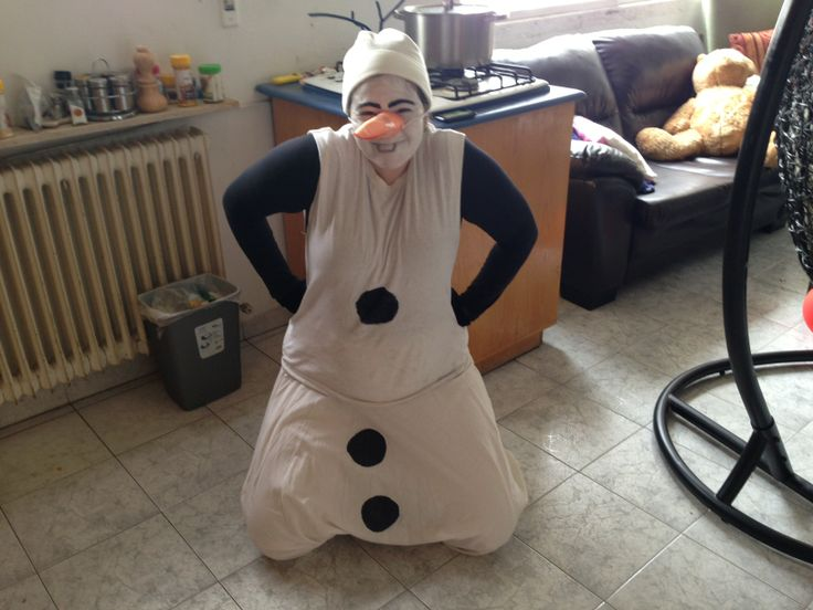 Homemade Olaf Purim Costume!  White aladdin pants with buttons drawn on, white hanes undershirt with sleeves cut off and button drawn on. Black long-sleeve shirt and black gloves. White hat with pipecleaners sewn on. White facepaint, black eyebrows, drawn-on bucktooth and orange construction-paper nose (held on by elastic). Easy and fun :)