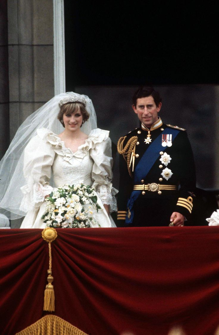 LONDON, UNITED KINGDOM - JULY 29:  Prince Charles And Princess Diana On The Balcony Of Buckingham Palace On Their Wedding Day.  The Princess Is Wearing A Wedding Dress Designed By David And Elizabeth Emanuel.  The Prince Is Wearing Naval Dress Uniform.  (Photo by Tim Graham/Getty Images) via @AOL_Lifestyle Read more: https://www.aol.com/article/entertainment/2017/03/30/old-photos-princess-diana-prince-charles-viral/22019148/?a_dgi=aolshare_pinterest#fullscreen