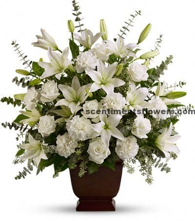 Flower Arrangement for Funeral can be designed beautifully with the strong flower fragrant. You may choose jasmine, rose and the other flowers which will be nice flower for funeral.