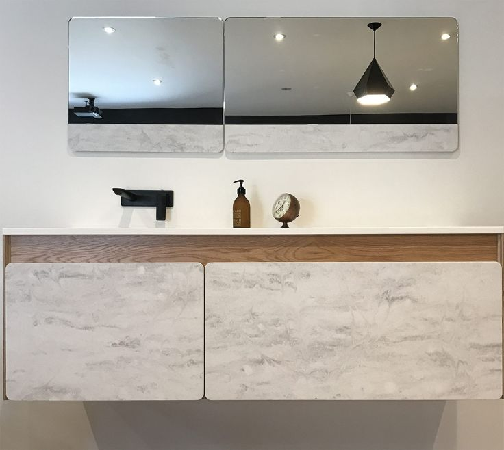 Rain Cloud Vanity by Formed  Winner Edition 4, Product Category, Corian Design Awards 2016.  Colours used: Rain Cloud Glacier White  Application: Drawer fronts Vanity top Integrated basin Mirror accent panels