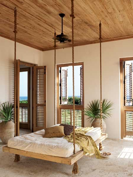 Invite the breeze but not the neighbors. When closed, louvered shutters on windows and doors offer privacy but allow ocean air to filter through. The natural colors and fibers on this porch remind you that you're at the beach. (Photo: Colleen Duffley) love the wall color for my ceiling!
