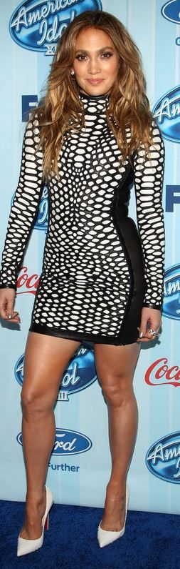 Who made Jennifer Lopez's white snake pumps and black print long sleeve dress that she wore in Los Angeles on January 14, 2013?