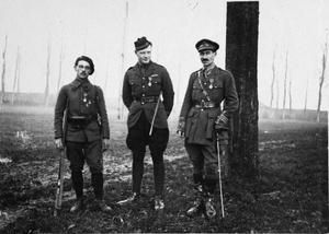 WWI, 18 Nov 1917; Corporal Paani of the 116th Regiment of the French Light Infantry (Chasseurs a pied), Captain Napier of the Royal Flying Corps and Major Burckhart of the Royal Artillery after the investiture ceremony at Bergues where they were decorated with the Legion of Honour by General Francois Anthoine, the Commander of the French First Army   ©IWM (Q 78979)