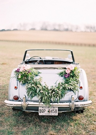 italian tradition of flowers on the getaway car