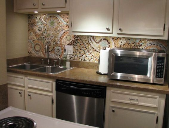 A paisley mosaic backsplash? It'd definitely have to be in the right kitchen, but I'd cook all the time if I got to look at this, haha.