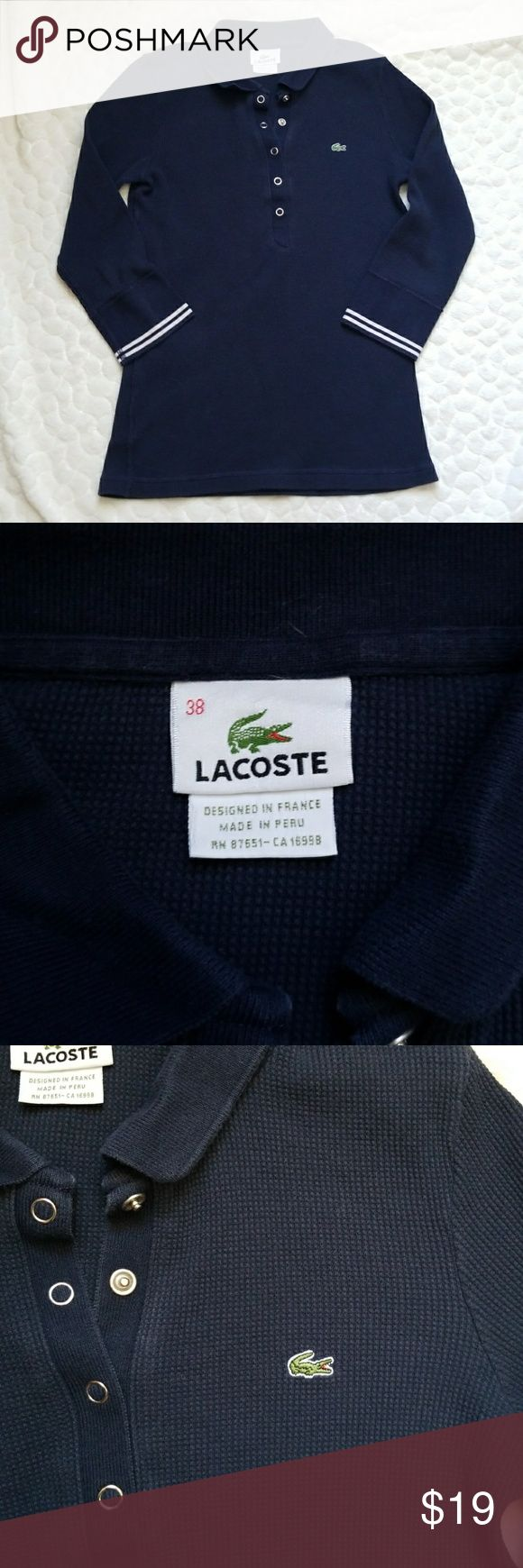 Lacoste waffle knit polo shirt top navy thermal 38 ***Lacoste waffle knit polo. Navy blue thermal style top with buttons and a collar. Size is 38 (according to Lacoste website, that's a size 6. See p ice of measurements). Materials are not listed but it feels like a stretchy thermal-really comfy. Shirt does shows signs of wear with fading. No rips or stains.*** Lacoste Tops