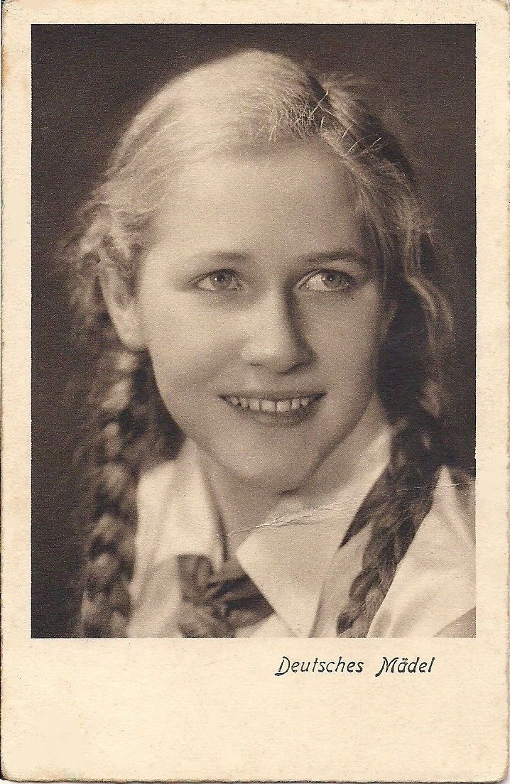 """Deutsches Mädel"" (German girl), a member of the Bund Deutscher Mädel (League of German Girls), also known as BDM, the only female youth organization in Nazi Germany, via Jedem das seine. It was the female branch of the overall Nazi Party youth movement, the Hitler Youth."