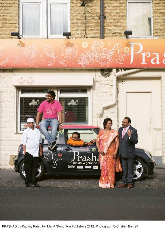 The Patel family outside the original Prashad Indian vegetarian restaurant in Bradford, West Yorkshire.