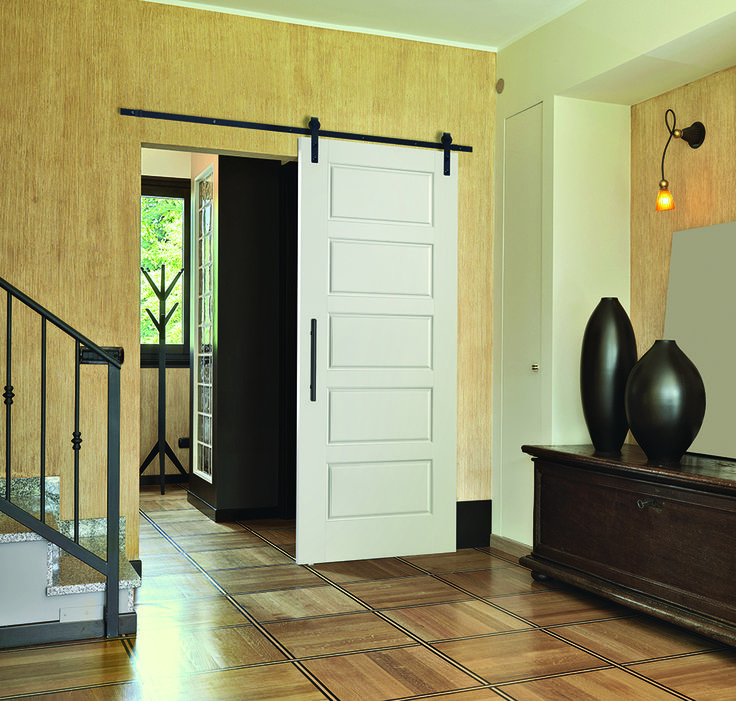 Welcome guests into your home with open doors a masonite for Solid wood interior barn door