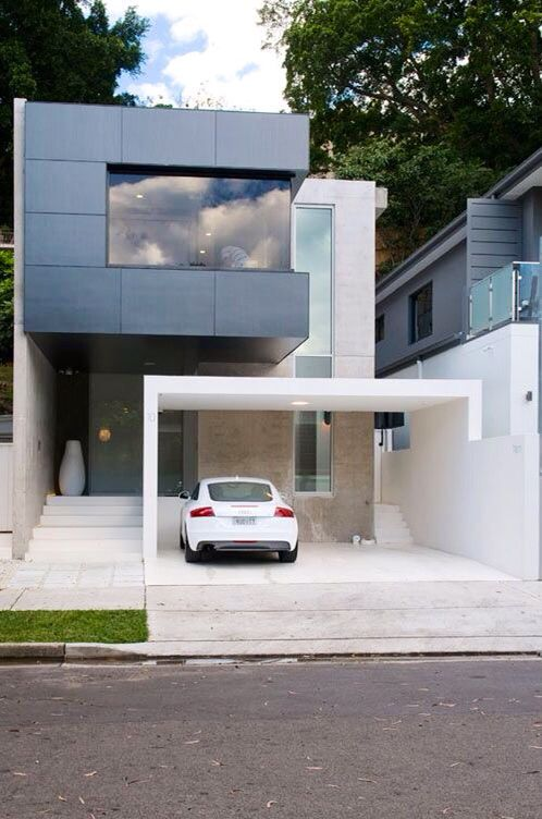love the forms projecting Modern townhouse