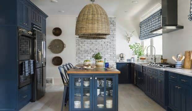 At Home: Bold color on kitchen cabinets is a 'thing' Conventional wisdom says to use neutral colors or simple wood stains for anything as permanent as kitchen cabinets. Homeowners craving a burst of color have generally been advised to bring it in through easily changeable items like curtains or seat cushions.