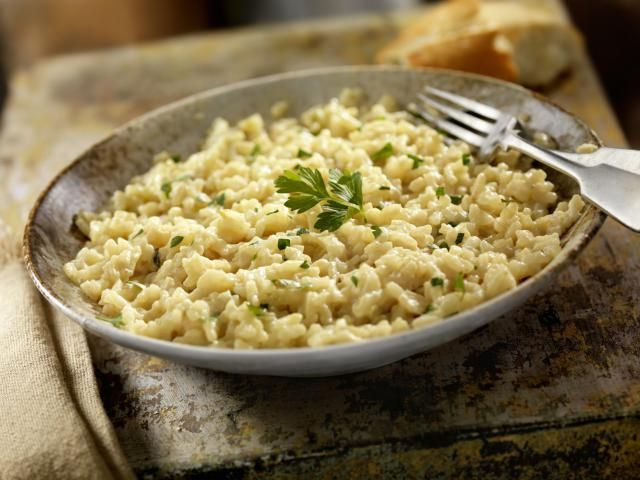 If you've never made risotto before, this easy recipe is a great place to start. This simple Italian classic is finished with butter and parmesan cheese.