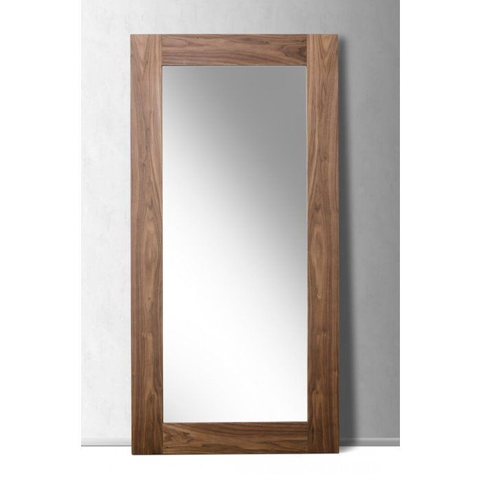 Merging rustic style with clean-lined design, this Scandinavian-inspired floor mirror is a welcome addition to your master suite. Made from manufactured wood with walnut veneers in a rich woodgrain finish, this full length looking glass features a flat glass mirror and simple rectangular silhouette. For a curated ensemble in your bedroom, start by rolling out a diamond shag area rug to define the space, then arrange a reclaimed wood nightstand with iron hairpin legs on each side of a…