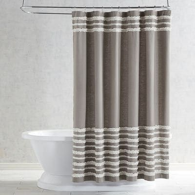 Raw-edged ruffles and stripes highlight this charming cotton shower curtain.