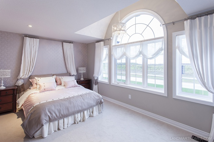 Beautiful arched windows letting in lots of sunlight to this Penny Lane Estates bedroom. By Landmart Homes. Stoney Creek, Ontario. #hamont #bedroomideas