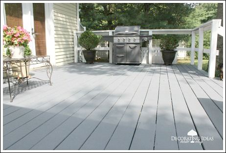Behr Deck over deck stain in cape cod grey.  Love it!                                                                                                                                                                                 More