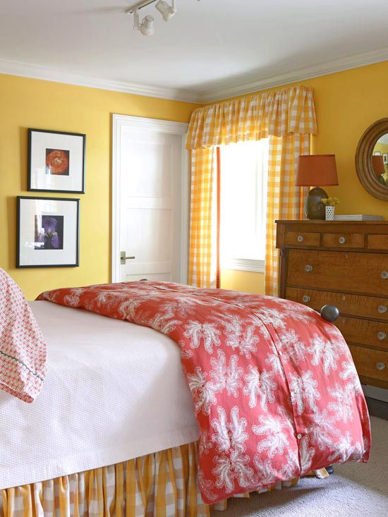 Warm Color Scheme              All warm colors have a natural affinity for each other so a color palette of yellow and red makes a cozy combination in this small bedroom. The antique wood bureau brings more warmth to the room and enhances its traditional style. The white ceiling, trim, and bed linens provide neutral visual breaks and keep the palette light.