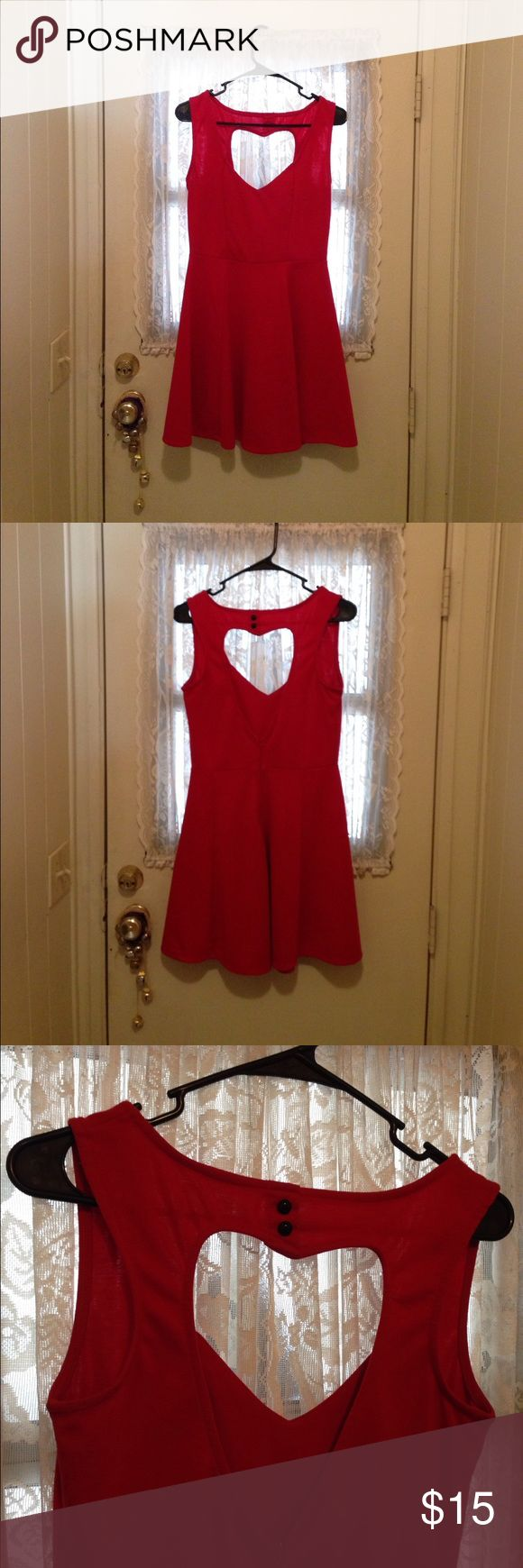 Adorable Soft Med Wet Seal Heart Back Dress This supersoft super adorable, very 30 red heart backed dress is just perfect for summer! In great condition with black vintage buttons in the back above the heart. Very cute and very flirty super adorable and soft. Size medium wet seal Wet Seal Dresses Mini