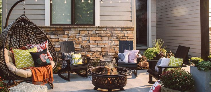Style your patio space for the changing seasons. Fire pits and patio heaters keep guests cozy, and basic black Adirondack chairs provide comfy seating. Planters add a pop of nature, while pretty pillows and practical patio side tables complete the look.