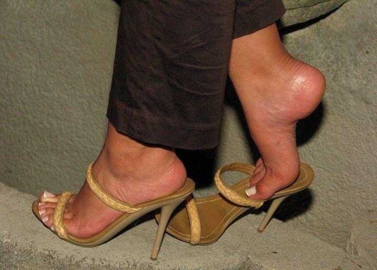 Mesmerizing feet — Footplay in high heels.