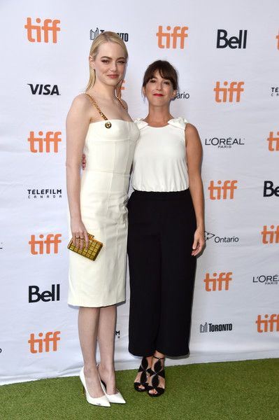 "Emma Stone Photos Photos - Emma Stone (L) and Martha MacIsaac attend the ""Battle of the Sexes"" premiere during the 2017 Toronto International Film Festival at Ryerson Theatre on September 10, 2017 in Toronto, Canada. - 2017 Toronto International Film Festival - ""Battle Of The Sexes"" Premiere"