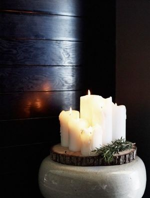 Candles... notice the slice of wood the candles are on, love it!!!  This would be cheap but pretty for a wedding too!