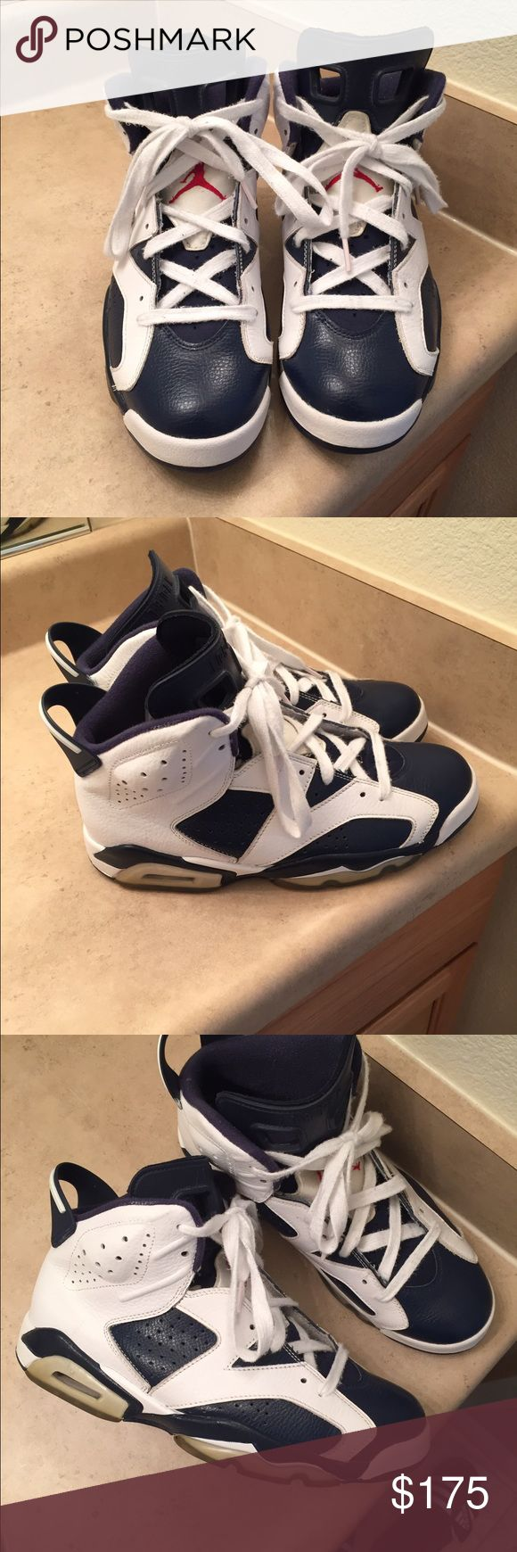 BLUE AND WHITE JORDAN 6's SIZE 9.5 Slighty used but in great condition.. Dont have tha original box.. Jordan Shoes Sneakers