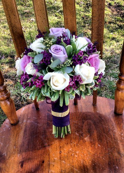 Cluster of Ivory and Ocean Song lavender roses accente with plumb colored  wax flowers - white/purple/green combo (maybe go lighter on the green color)