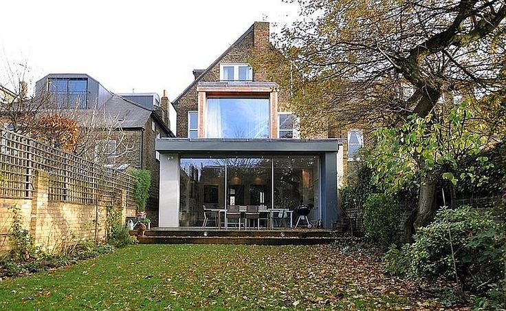 Moderne aanbouw met plat dak - grote schuiframen