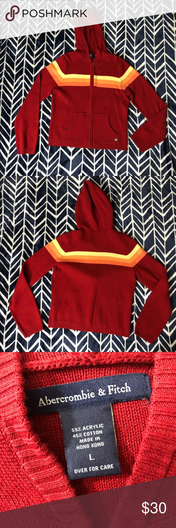 """Abercrombie & Fitch Hooded Sweater Woman's size large Abercrombie and Fitch Zip Up Hooded Sweater. Like new. No fading, pilling, holes or stains. Red, yellow and orange. The chest measures 18 1/2"""" flat across, the underarm sleeve length is 19 1/2"""" and this is 21 1/2"""" long from the tag. Abercrombie & Fitch Sweaters"""