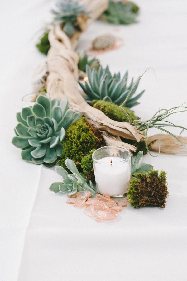 driftwood, moss, and succulent centerpiece, photo by Nathan Russell Photography http://ruffledblog.com/round-mountain-texas-wedding #weddingideas #centerpieces
