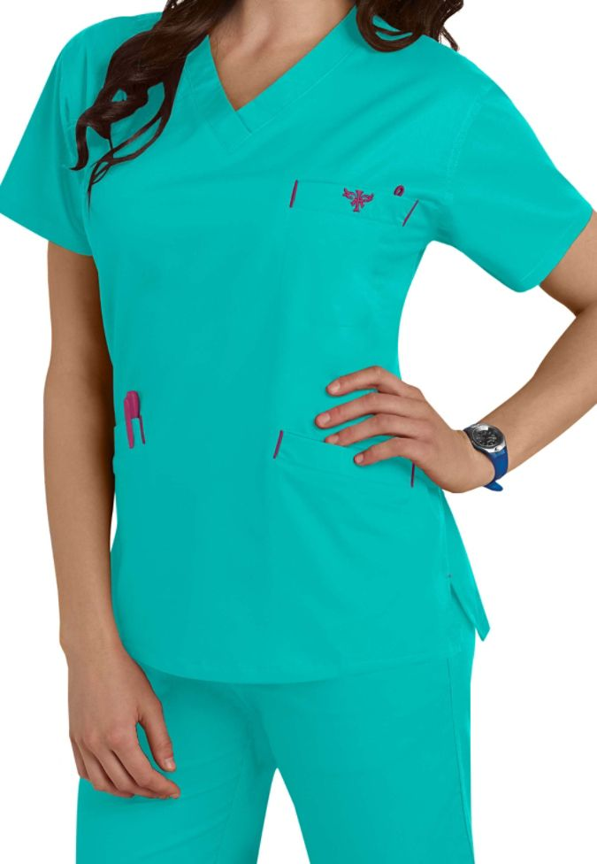 Comfort and durability are the trademarks of this classic v-neck scrub top from Med Couture! The Signature top (in Real Teal) is made of a stretch material that will keep you comfortable all shift long. Includes roomy pockets for your accessory needs.