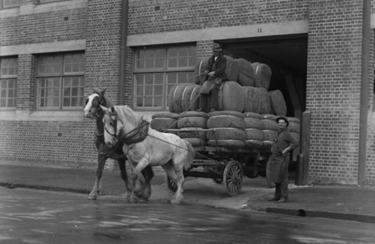 Dalgety Wool Stores at Fremantle -- Bales of wool are carted out of the woolstores building.