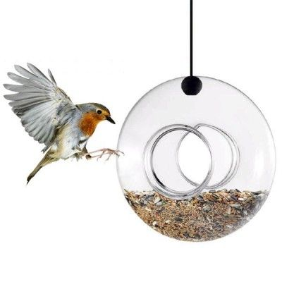 Eva Solo's stylish and beautiful hanging bird feeder that made from hand blown glass, Uses the included fixture to attach it to a branch or under an overhang. Danish designed for everyday objects in the home. The product consists simplicity, distinct lines and the high degree of functionality.  #UniqueGiftsIdeas #CoolGiftsIdeas #UniqueChristmasGifts #GiftIdeasForHer #UnusualGiftsForHer #GiftsForWomen