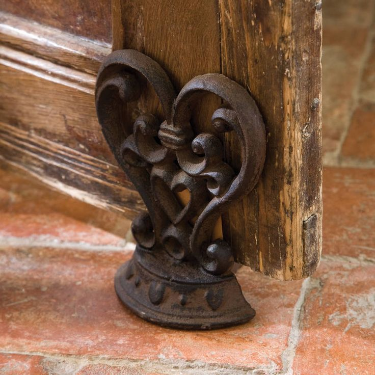 Heart shaped door wedge, making the perfect 6th wedding anniversary gift. Decorate any room with this timeless doorstop.A beautiful and ornate door stop in a timeless heart shaped design. A fully assembled structure made from heavy and long lasting cast iron finished in dark rustic brown designed to compliment most home decor. There certainly won't be any banging doors with the help of this little fellow! Nothing expresses love, appreciation and sentimental value than a Heart shaped gift…