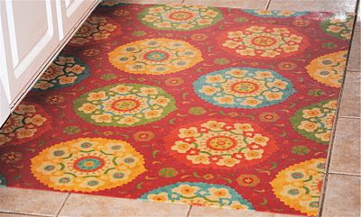 DIY fabric and vinyl rug...I think I might do this for the bathroom downstairs.  The kids use it to wash up from being outside, but it is also the guest powder room.  I wanted a rug, but didn't know how I was going to keep it clean and presentable (think dirty, little outside-summer feet AND potty training 3 year old).  This just might be the perfect solution...