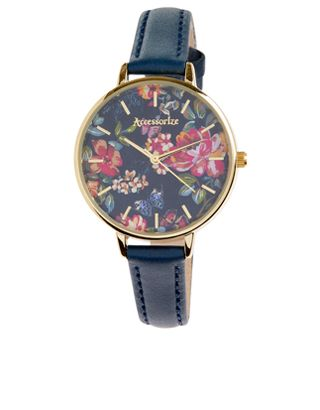 This beautiful watch is adorned with a pretty floral-print dial, real leather straps and a gold-tone metal case.<br /><br /><a href=