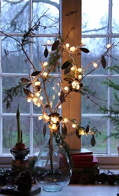 wrap a small string of lights around winter foliage in a vase