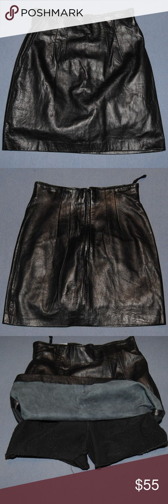 """UNIQUE Leather Mini Skirt with attached shorts So adorable and sexy. This skirt is intended as a tennis or sports skirt but I think the attached shorts make it easy club attire. The skirt shell is 100% leather the attached shorts are 100% acetate Tag size 6 Waist measures 12.5"""" inches Length is 16"""" inches Skirt is in excellent condition ( the piling you see on the shorts is from the leather on the inside of the skirt) Erez Sport Skirts Mini"""
