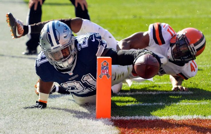 Cowboys vs. Browns:  35-10, Cowboys  -  November 6, 2016  -   Dallas Cowboys running back Ezekiel Elliott (21) dives for a touchdown against Cleveland Browns free safety Tracy Howard (41) in the first half  of an NFL football game, Sunday, Nov. 6, 2016, in Cleveland. (Credit: AP / David Richard)