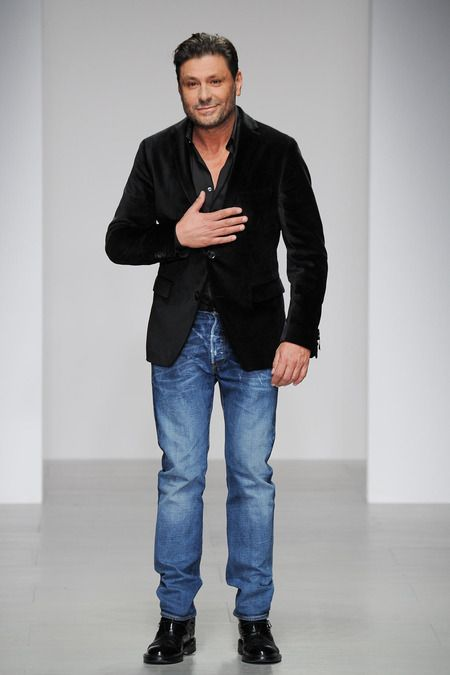 Designer Filippo Scuffi greets the audience after showcasing his Daks | Fall/Winter 2014 Ready-to-Wear Collection | February 14 2014; London
