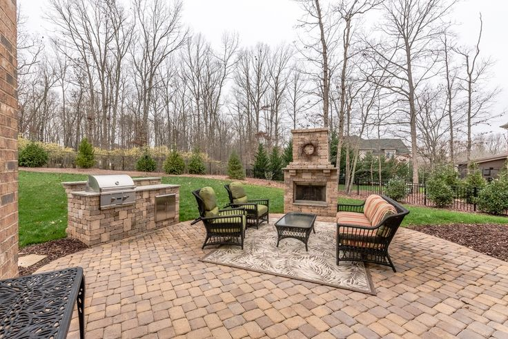 Transitional Patio with exterior tile floors, Outdoor kitchen, outdoor pizza oven, Fence