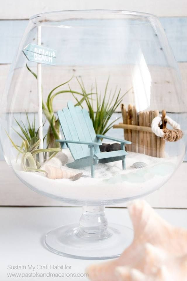 This is really adorable. Take a wine glass and recreate this beach style garden by adding the things shown. It can be a really innovative piece of craft.